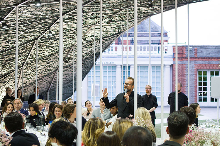 Mikolaj Sekutowicz, Therme Art Curator, giving a speech during 2019 Serpentine Pavilion celebrations